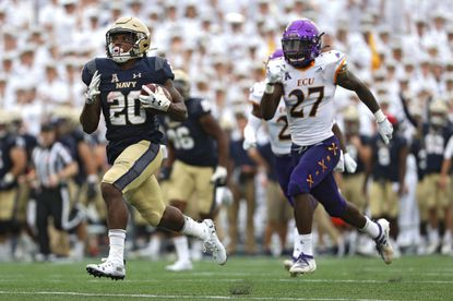 Slotback C.J. Williams races toward the end zone en route to scoring a touchdown against East Carolina last season. Saturday's game between the Midshipmen and Pirates has been green-lighted by the American Athletic Conference. (Photo by Patrick Smith/Getty Images)