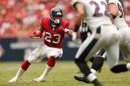 Texans running back Arian Foster rushes against the Ravens during the second half of their Oct. 21, 2012, game at Reliant Stadium.