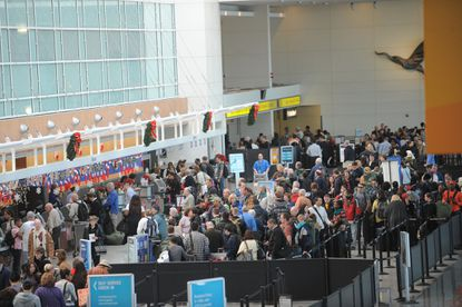 Holiday travelers crowd BWI Thurgood Marshall Airport in 2012.