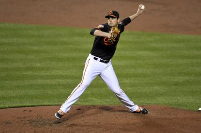 Orioles pitcher T.J. McFarland throws in the seventh inning against the Kansas City Royals at Oriole Park at Camden Yards.