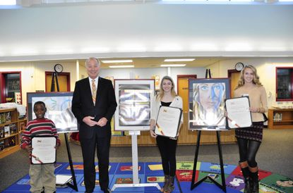 From left, Rockburn Elementary second-grader Jayden Kelly, Maryland Comptroller Peter Franchot, Glenwood Middle eighth-grader Sarah Cooper and Howard High senior Kaitlynn Motley stand with their art and proclamations from Franchot. The students were winners of Franchot's Maryland Masters Award, and their art will hang in his Annapolis office for two months.