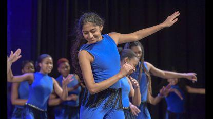 Hammond High School's Mandi Bhatt on stage for a dance class at the Columbia school on Wednesday.