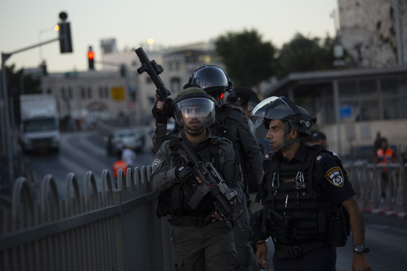 """Israeli police deploy at a Palestinian protest at the Damascus Gate to the Old City of Jerusalem Thursday, June 17, 2021 against incendiary chants used by ultranationalist Israelis at their """"Flags March"""" at the same site on Tuesday."""