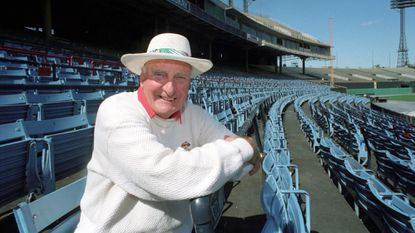 """Chuck Thompson, known for his catchphrases """"Ain't the beer cold!"""" and """"Go to war, Miss Agnes!"""" came to Baltimore in 1949 to broadcast the games of the International League Orioles and never left. He's shown here Sept. 27, 1991, at Memorial Stadium."""