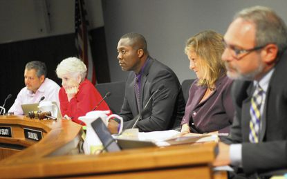 Howard County Council Chairman Calvin Ball (center) said an independent analysis of the county's largest tax increment financing deal is essential to move forward.