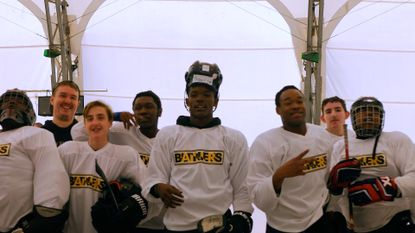 "Tyrone ""Savage"" Carey, center, with his Baltimore Banners teammates and assistant coach Taylor Handleton, second from left."