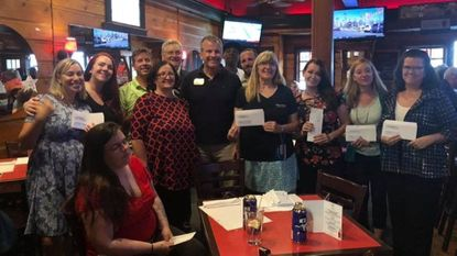 The check distribution from The Greater Catonsville Chamber of Commerce and the Knights of Columbus at Jennings Cafe on Wednesday, Oct. 10.