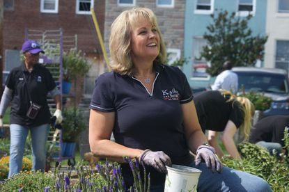 In an Oct. 3, 2016 photo, Maryland Del. Kathy Szeliga, a Republican running for U.S. Senate, works in a garden at the Martin Luther King Jr. Recreational Center in Baltimore. Szeliga, who has criticized the Donald Trump publicly, questions why her opponent, Rep. Chris Van Hollen, hasn't been as quick to speak out against Hillary Clinton's missteps. (AP Photo/