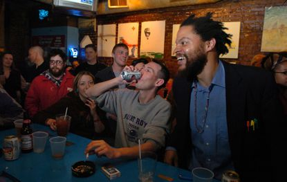 Patrons gather at Mount Royal Tavern to honor bartender Ralph Retz after he died of cancer in 2006. The bar was just named one of the country's best by Esquire magazine.