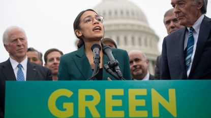 Rep. Alexandria Ocasio-Cortez and Sen. Ed Markey speak during a press conference to announce Green New Deal legislation to promote clean energy programs.
