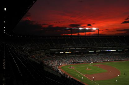 The sunset is seen in a general view as the Kansas City Royals play the Orioles during the fourth inning at Oriole Park at Camden Yards on August 21, 2019 in Baltimore.