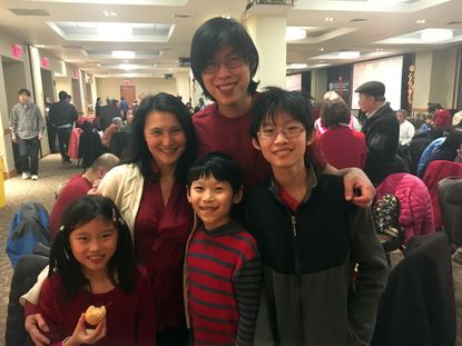 Tim Chng and Valerie Chng-Lim of Baltimore pose with their children (left to right) Skye, 9, Sage, 11, and Seth, 13, at the lunar new year celebration hosted by the Taiwanese Association of America-Greater Baltimore & Columbia Chapter.