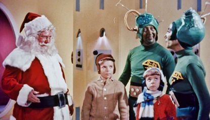 """John Call, left, as the title elf in """"Santa Claus Conquers the Martians."""""""