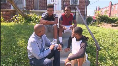 CNN anchor-reporter Victor Blackwell (front-left) with three West Baltimore teens, Kyrique Jones, Terry Brown and Jamel Phillips. The three received admission and all expenses paid to Bethune-Cookman University after being interviewed by Blackwell.