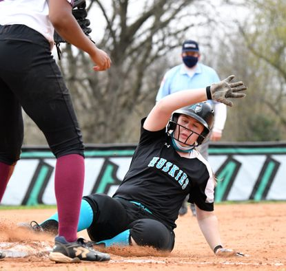 Patterson Mill baserunner Tara Caprinolo slides safely into third base during Friday's game visiting Havre de Grace.