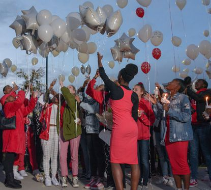 Those mourning Kayla Winter Perry, who was killed in a car accident in October, released balloons into the sky in her honor at a vigil last fall. Proposed legislation in the Maryland General Assembly would prohibit such releases out of environmental concerns.