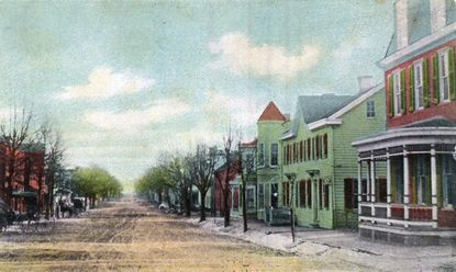 The west side of Main Street in Manchester is shown on this tinted postcard circa 1898.