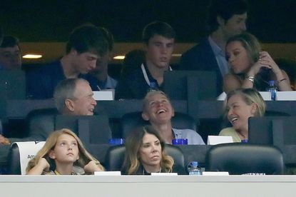 President George W. Bush shares a laugh with comedian, actress and talk show host Ellen DeGeneres and her wife Portia de Rossi during the Dallas Cowboys NFL game against the Green Bay Packers, Sunday, Oct. 6, 2019, in Arlington, Texas. The Packers defeated the Cowboys 34-24. (Kevin Terrell via AP) User Upload Caption: