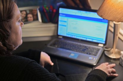 Single mother Lisa Andersen navigates the state of Maryland government website while fighting to keep her unemployment benefits, yet the state seeks to recoup overpayments from tens of thousands of unemployment claimants. (Karl Merton Ferron/Baltimore Sun Staff)
