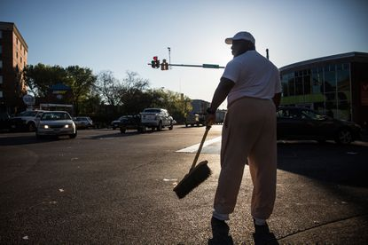 Victor Huntley-el helps clean up debris from a CVS pharmacy in Baltimore that was set on fire during rioting after the funeral of Freddie Gray.