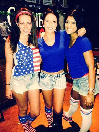 Looney's of Bel Air employees Darian Smelser, left, Abby Faust and Shayleen Thomas were dressed up for the U.S.-Portugal match Sunday.