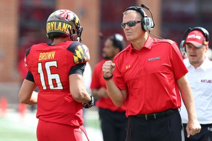 Maryland quarterback C.J. Brown is congratulated by head coach Randy Edsall following a touchdown against Ohio State.