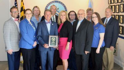 Harford County Executive Barry Glassman, center, and the team responsible for overseeing and operating Harford Transit LINK, celebrate the system's recent award from the Transportation Association of Maryland.