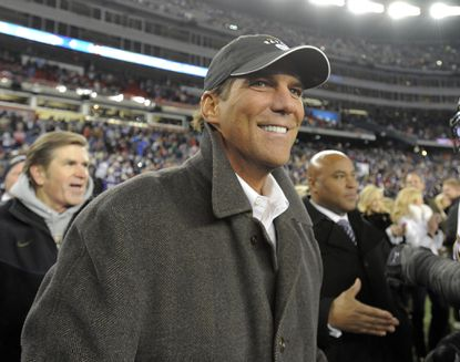 Owner Steve Bisciotti is all smiles after the Ravens' win over the Patriots.