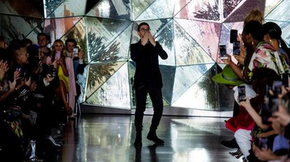 Christian Siriano takes the runway Saturday at the end of his futuristic-inspired collection during New York Fashion Week in New York City.