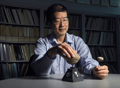 Andy Cheng, chief scientist at the Johns Hopkins University Applied Physics Laboratory (APL), is co-lead investigator on the Double Asteroid Redirection Test mission, or DART. The model is of a binary asteroid. DART is NASA's first defense mission to deflect an asteroid heading for the earth into another orbit by smashing a spacecraft into it. APL is building the system.