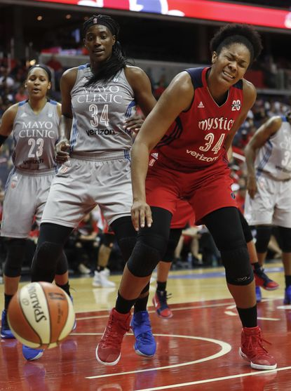 Washington Mystics center Krystal Thomas (34) reacts after losing control of the ball as Minnesota Lynx forward Maya Moore (23) and center Sylvia Fowles (34) look on during the second half of Game 3 of the WNBA basketball semifinals, Sunday, Sept. 17, 2017, in Washington.
