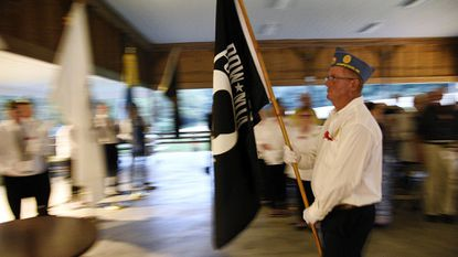 Roger Mazzone presents the POW/MIA flag during a ceremony at Hampstead American Legion Post 200 on Sept. 21, 2018. A free veterans dinner will be held at the Hampstead Legion on Nov. 11.