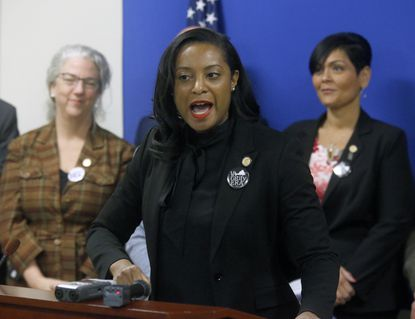 In this Jan. 22, 2019 file photo, Virginia Del. Jennifer Carroll Foy, D-Prince William, center, speaks during a news conference of ERA (Equal Rights Amendment) supporters after her ERA bill was killed by a House subcommittee inside the Pocahontas Building in Richmond, Virginia. (Bob Brown/Richmond Times-Dispatch via AP)