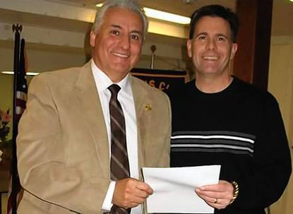Rocky Gonzalez, left, is presented a 25 year Chevron and Letter of Appreciation by Club President David Reed in recognition of 25 years of membership and service with the Churchville Lions Club. The Churchville Lions are supporting many efforts and organizations in the community, including First LEGO League, Leader Dogs, SIDS and SARC.