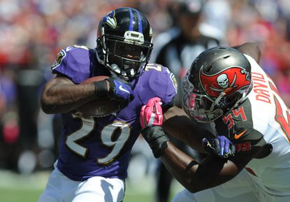 Running back Justin Forsett of the Ravens carries the ball against the Tampa Bay Buccaneers.