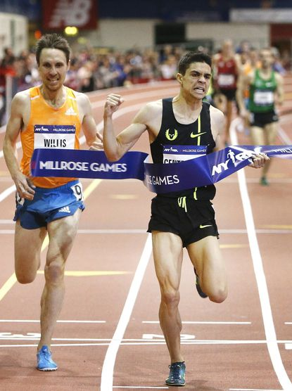Matthew Centrowitz, right, crosses the line ahead of Nick Willis in the men's Wanamaker Mile during the Millrose Games, Saturday, Feb. 14, 2015, in New York. Centrowitz won the race in 3 minutes, 51.35 seconds.