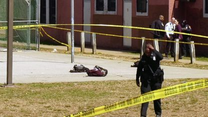 Police investigate a double shooting near Green Street Academy in Southwest Baltimore.