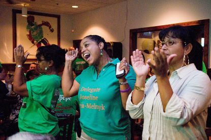 (Staff photo by Nicole Martyn) Democratic candidates in the District 21 state delegate race gathered to watch the returns at The Greene Turtle in Laurel after the polls closed for the primary elections Tuesday September 14, 2010. Here, candidate Joseline Pena-Melnyk (center) celebrates early returns. At left is Anne Arundel County Democratic Central Committee District 21 candidate Sandy Hines and at right is Pena-Melnyk campaign volunteer Tammy Nin of Edison, New Jersey processed by IntelliTune on 14092010 224931 with script Transport