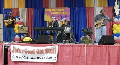 Josh Christina, center on keyboards, performed with other members of the band, Good Old Stuff, in October 2013 at the Baby Boom Expo in Timonium.