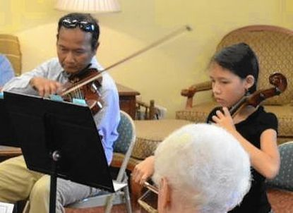 Bagus Wiswakarma, shown performing with daughter Aileen Wiswakarma in 2014, brings a program exposing kids to the violin and piano to the Finksburg branch library on Sept. 19.
