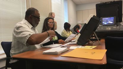 Baltimore County elections judges tabulate votes from Republican provisional ballots at the elections office in Hunt Valley on Thursday morning. Later in the day, they plan to begin reviewing Democratic provisional ballots.