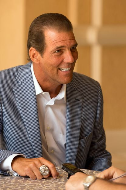 Ravens owner Steve Bisciotti answers questions during an interview at the NFL's owners meetings on Monday in Orlando, Fla.