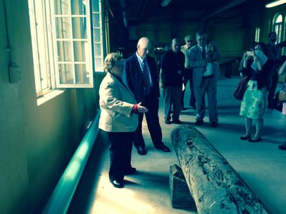 Maryland Sens. Ben Cardin and Barbara Mikulski look at a wooden water pipe on display at Montebello water treatment plant.