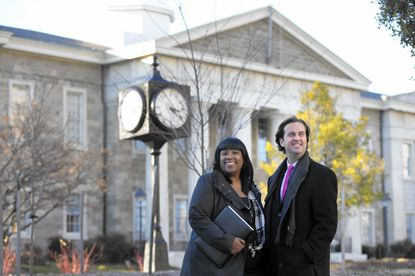 Director of Government Relations Yolanda Winkler, left, and Chief Legislative Officer Nick Blendy, right, pose for a photo together outside of the Baltimore County Historic Courthouse in Towson, on Tuesday, Dec. 20, 2016.