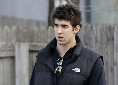 """Michael Phelps leaves the Meadowbrook Aquatic Center Wednesday. """"It's definitely not what I wanted, and it's clearly not what my mom wanted,"""" Phelps of the tabloid photo showing him apparently smoking marijuana."""