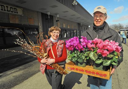 Dianne and Jim Hoffman of Reisterstown bought a spray of pussy willows and some cyclamen plants. Visitors got a dose of spring at the last day of the Maryland Home and Garden Show at the Maryland state fairgrounds.