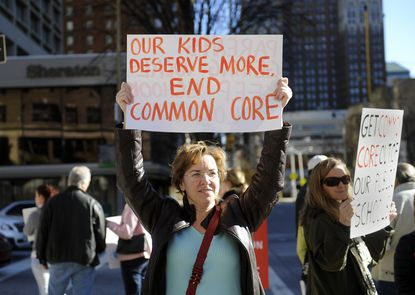 "Ann Miller, of Phoenix in Baltimore County, organized a group of parents and other concerned citizens to hold a protest against the proposed ""Common Core"" curriculum in this 2013 photo."