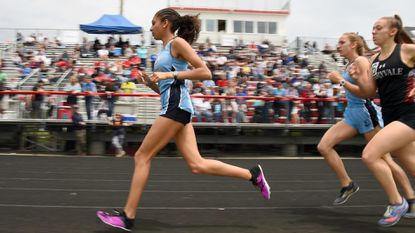 Juliett Whittaker of Mount de Sales wins the 1600 at the IAAM championships at Archbishop Spalding.