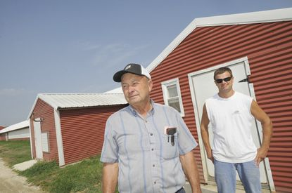 Lemmie Swann of Talbot County has raised chickens for years as well as corn, wheat and soybeans. His sons, including Danny, 38 (right), run the family's chicken houses now.