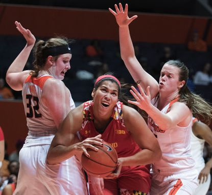 Maryland center Brionna Jones, center, tries to get past Illinois center Chatrice White (32) and forward Alex Wittinger (35) during the first half of an NCAA college basketball game in Champaign, Ill., Thursday, Dec. 31, 2015.